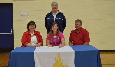Brenna Meyer on signing day with CSM.